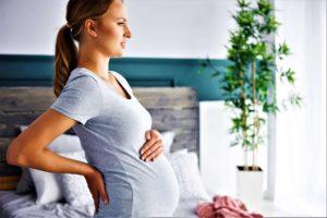 18 недель беременности болит спина